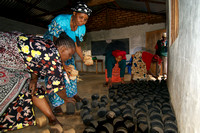 Legacy Foundation works with woman's project in Lushoto, Tanzania to develop alternative fuel from biomass, known as fuel briquettes. Photography by Peter Stanley, 2012.